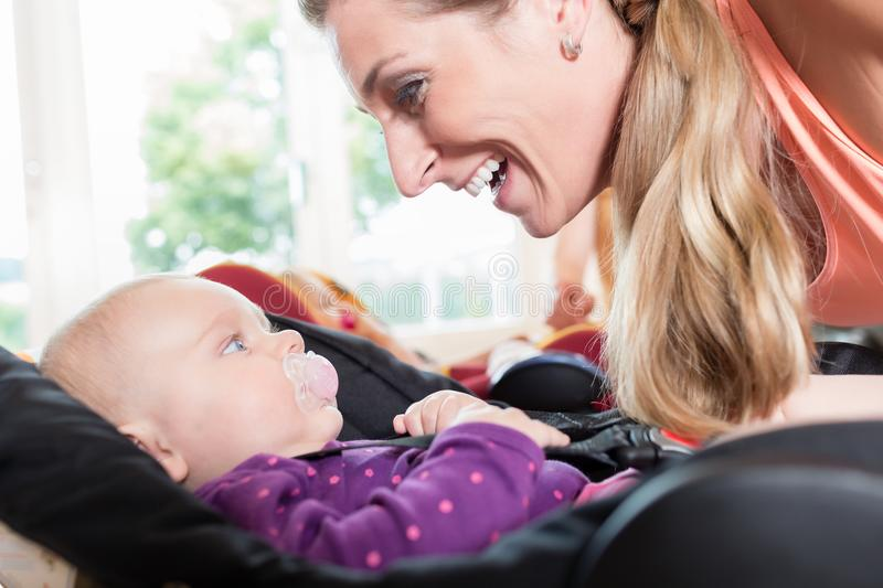 Moms and babies in mother and child course practicing stock image