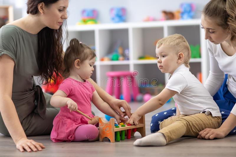 Moms with their babies in nursery stock photo