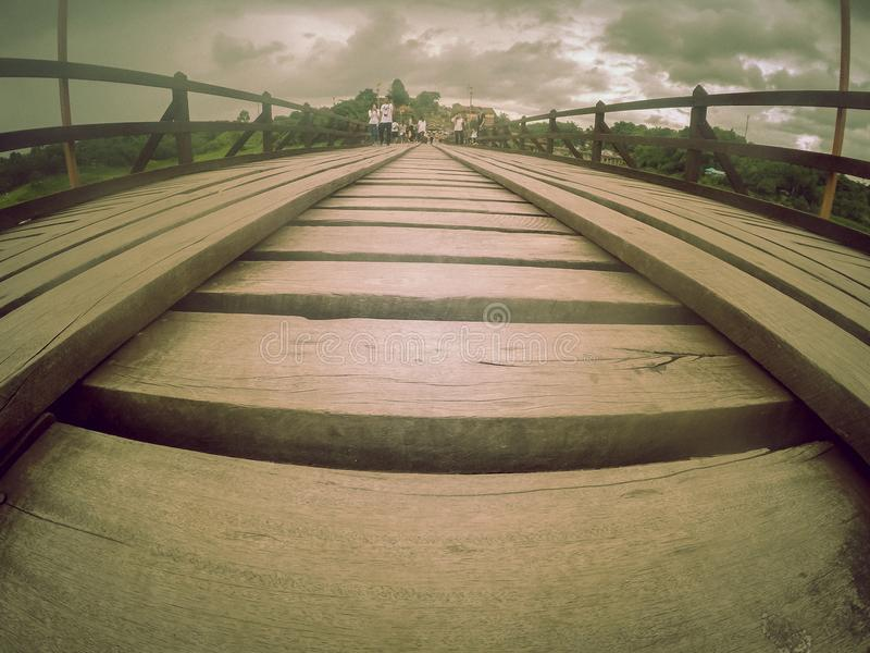 Mon bridgeUttama Nusorn Bridge in Sangkhlaburi district,Kanchanaburi province,Thailand.Thailand's longest wooden bridge and the royalty free stock photo