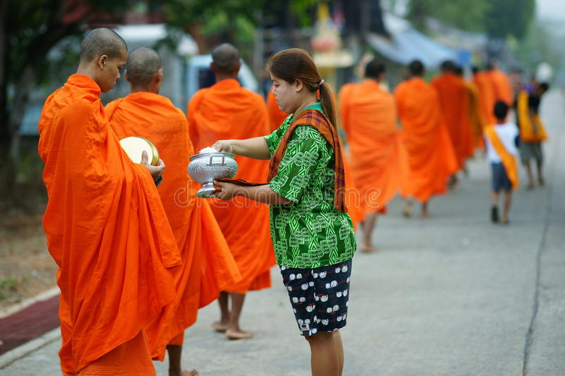 Mon buddhist monks collecting alms stock photos