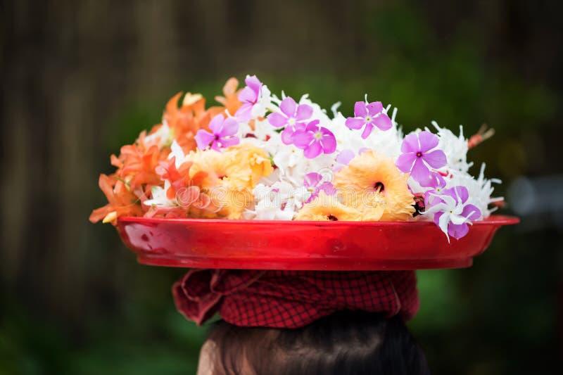 Mon girl carry flowers on head stock photos