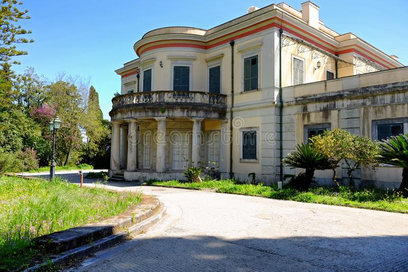The Mon Repos Palace wit its park in Corfu town, Greece.  royalty free stock image