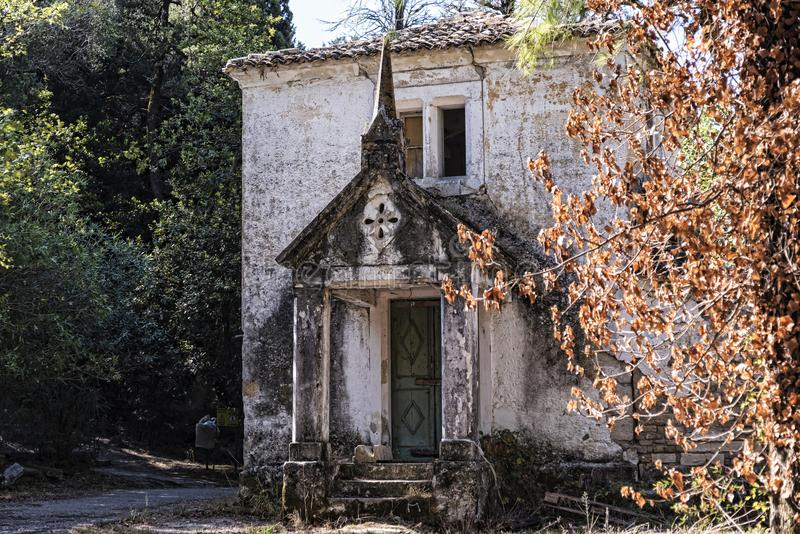 Dilapidated Cottage in the Grounds of the Mon Repose Palace in Corfu Greece. The Mon Repos villa was originally built as the summer residence for the British royalty free stock image