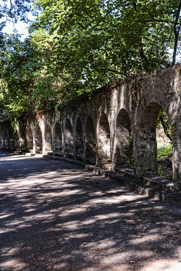 Arches in the Grounds of the Mon Repose Palace in Corfu Greece. The Mon Repos villa was originally built as the summer residence for the British Lord High royalty free stock photography