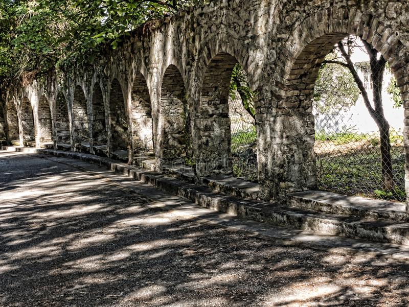 Arches in the Grounds of the Mon Repose Palace on the Greek Island of Corfu. Mon Repose Palace is where Philip the Duke of Edinburgh was born. Corfu which is a royalty free stock photos