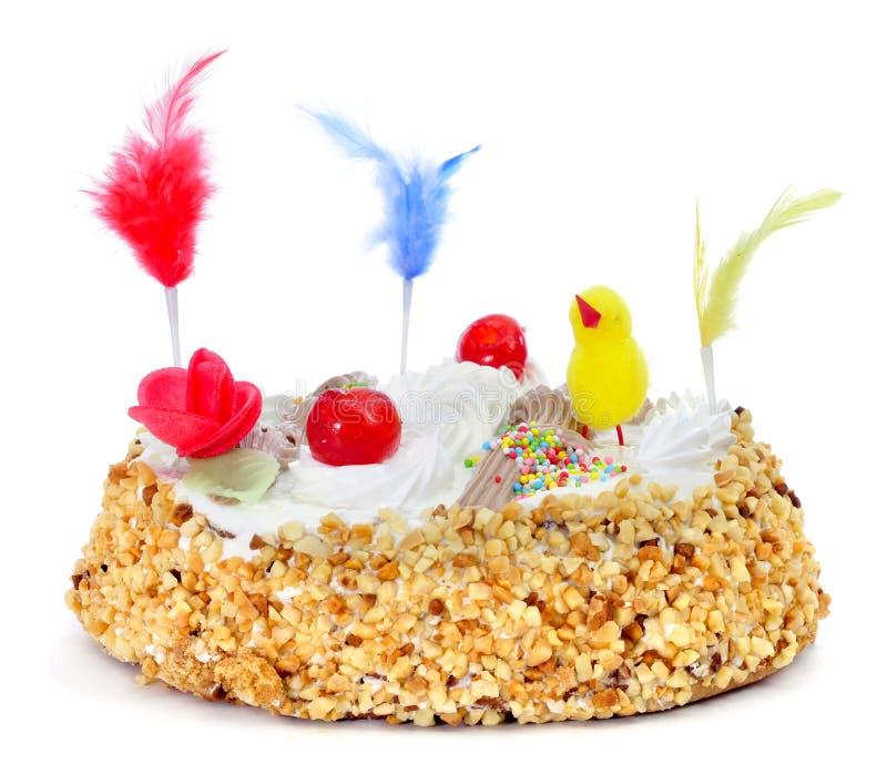 Mona de pascua, an ornamented cake eaten in Spain on Easter Monday. Closeup of a mona de pascua, a cake eaten in Spain on Easter Monday, ornamented with feathers stock photography