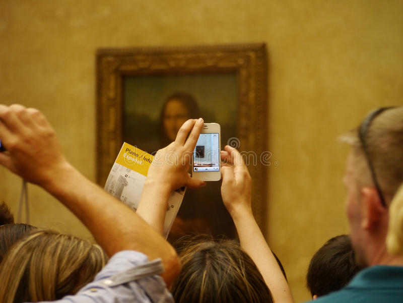 Mona Lisa in modern times, through the iPhone at the Louvre stock photography