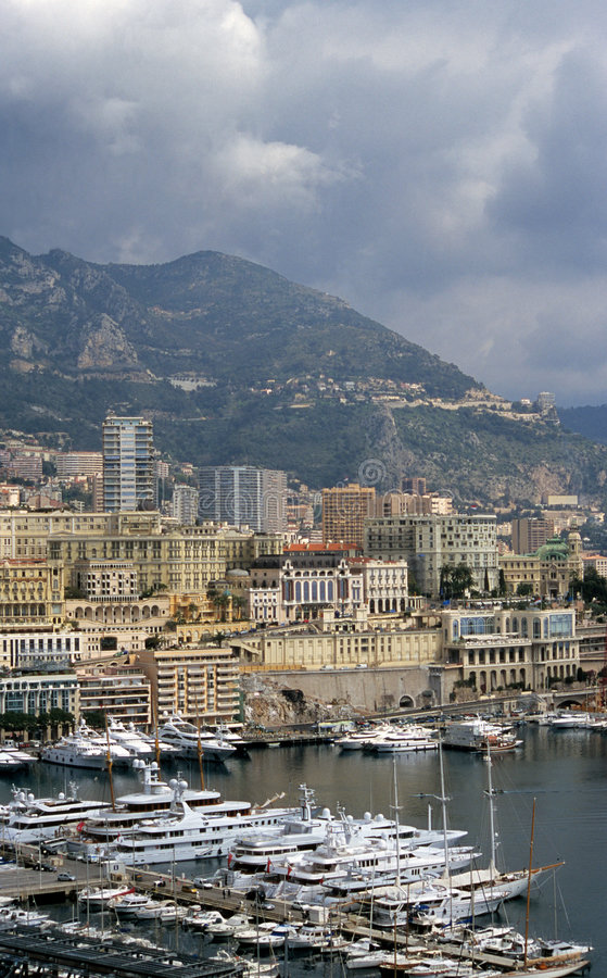 Monaco. Luxury yachts dock in Monaco, home of the Monaco Grand Prix and the Monte Carlo Casino visible in the background royalty free stock image