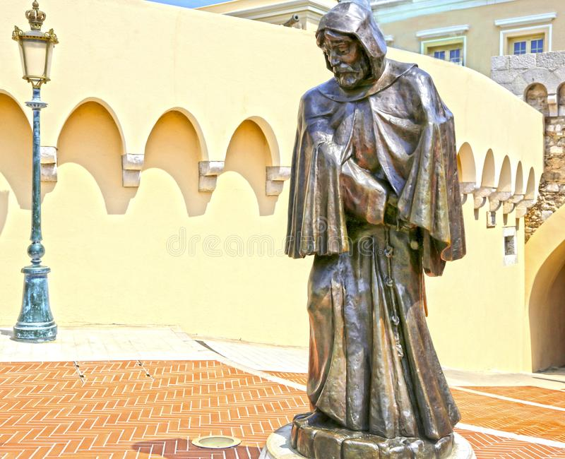 Monaco City, Monaco - June 13, 2014: bronze statue of Francois Grimaldi. Disguised as a monk in front of the Prince`s Palace of Monaco royalty free stock photography