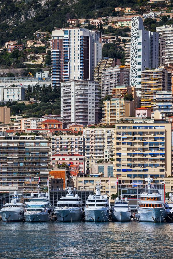 Monaco Cityscape. Monaco principality, yachts, apartment buildings, block of flats, houses on a steep coastal mountain slope royalty free stock photography