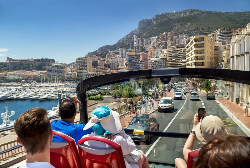 Monaco, France – July 24, 2017: Group of touristic people traveling by tour bus in luxury Monaco (Monte carlo). stock photo