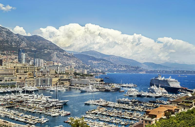 Monaco, France – July 24, 2017: Picturesque view of famous marina with huge tourist liner in luxury Monaco. stock photo