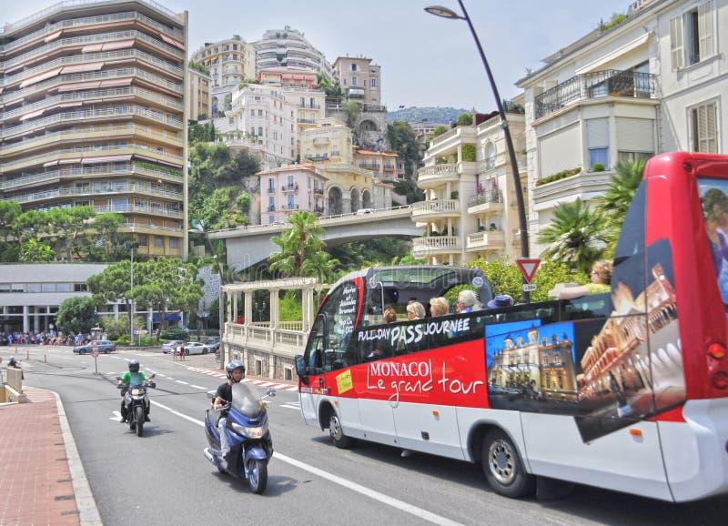 Monaco, Monaco - June 13, 2014: bright tourist bus on the street stock photos