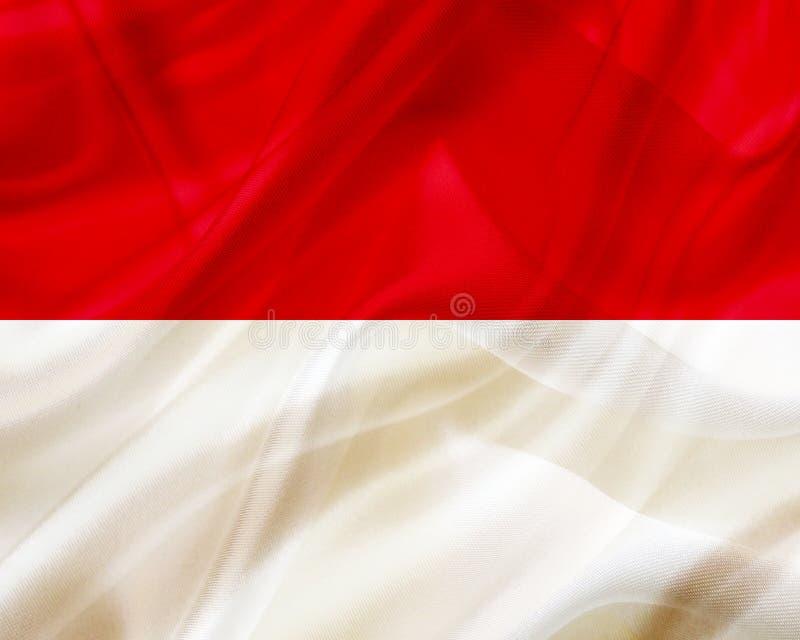 Monaco landsflagga på siden- eller silkeslen vinkande textur stock illustrationer