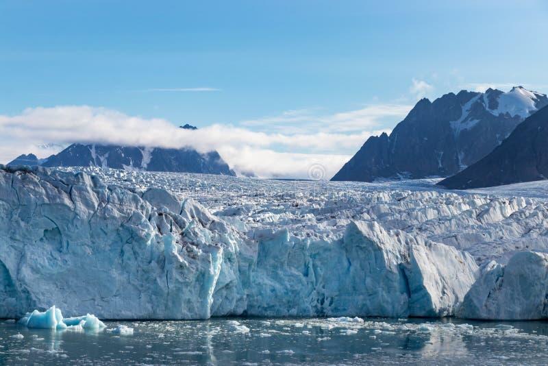 The Monacobreen - Monaco glacier in Liefdefjord, Svalbard, Norway. The Monacobreen Glacier at Liefdefjord, Svalbard, Norway royalty free stock image