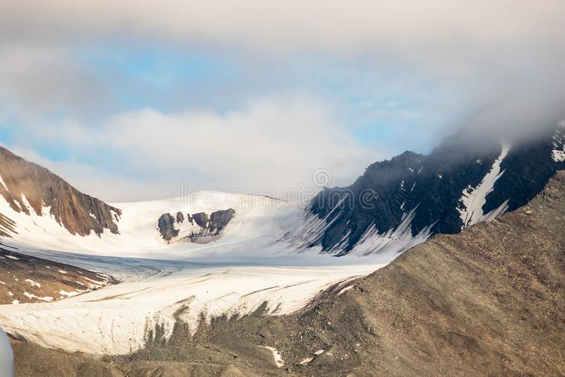 The Monacobreen - Monaco glacier in Liefdefjord, Svalbard, Norway. Detail of the Monacobreen Glacier at Liefdefjord, Svalbard, Norway stock photo