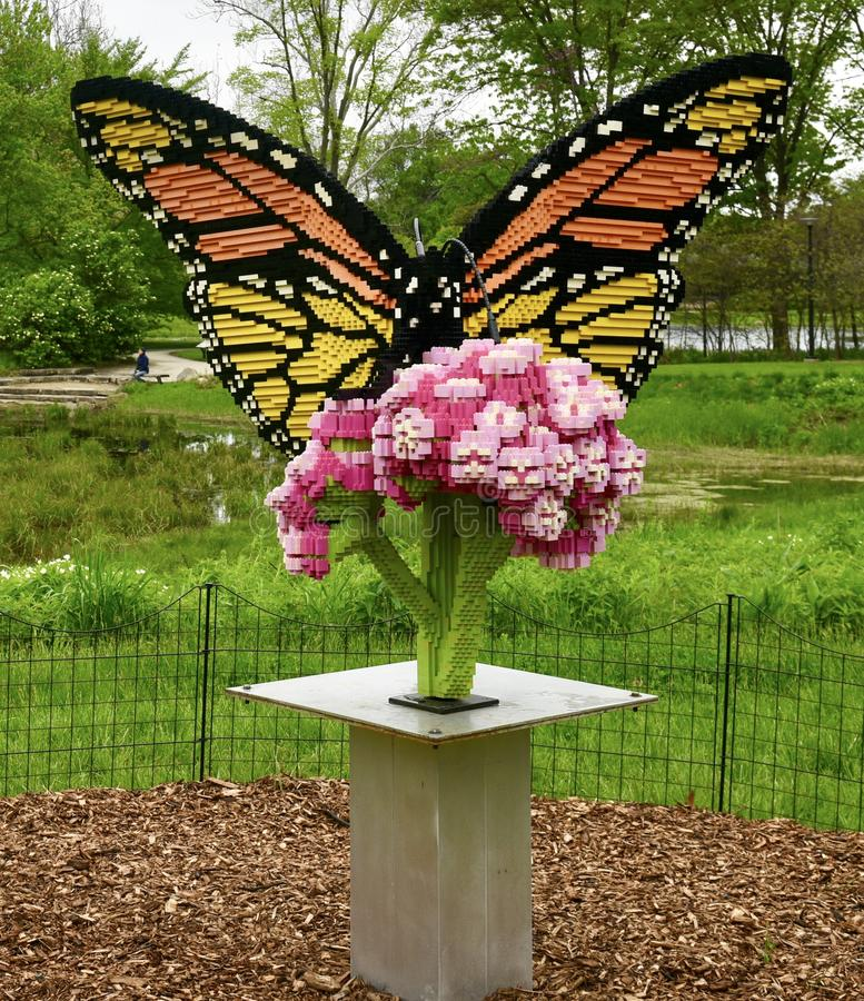 Monarch Butterfly on Milkweed. This is a Spring picture of a piece of public art titled: Monarch Butterfly on Milkweed, on exhibit at the Morton Arboretum in stock photography