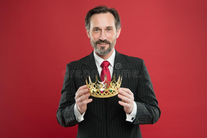 Monarchy attribute. Monarchy family traditions. Man bearded guy in suit hold golden crown symbol of monarchy. Become royalty free stock images