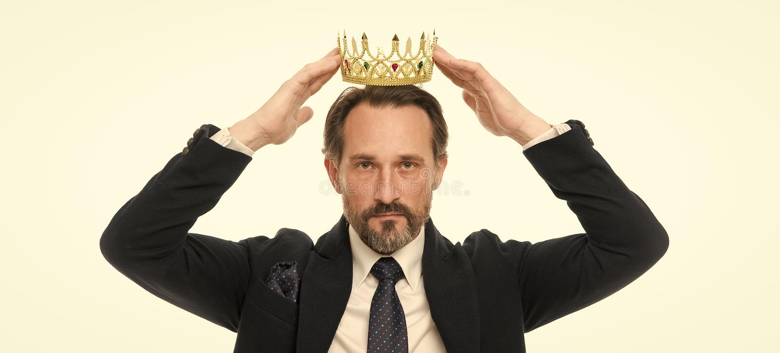 Monarchy family traditions. Man nature bearded guy in suit hold golden crown symbol of monarchy. Direct line to throne royalty free stock image