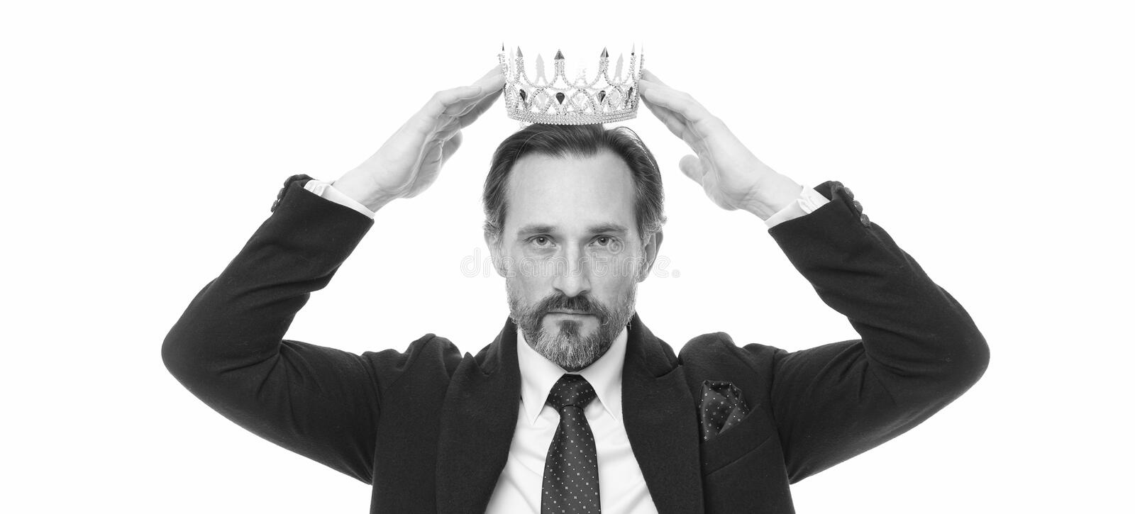 Monarchy family traditions. Man nature bearded guy in suit hold golden crown symbol of monarchy. Direct line to throne stock photography