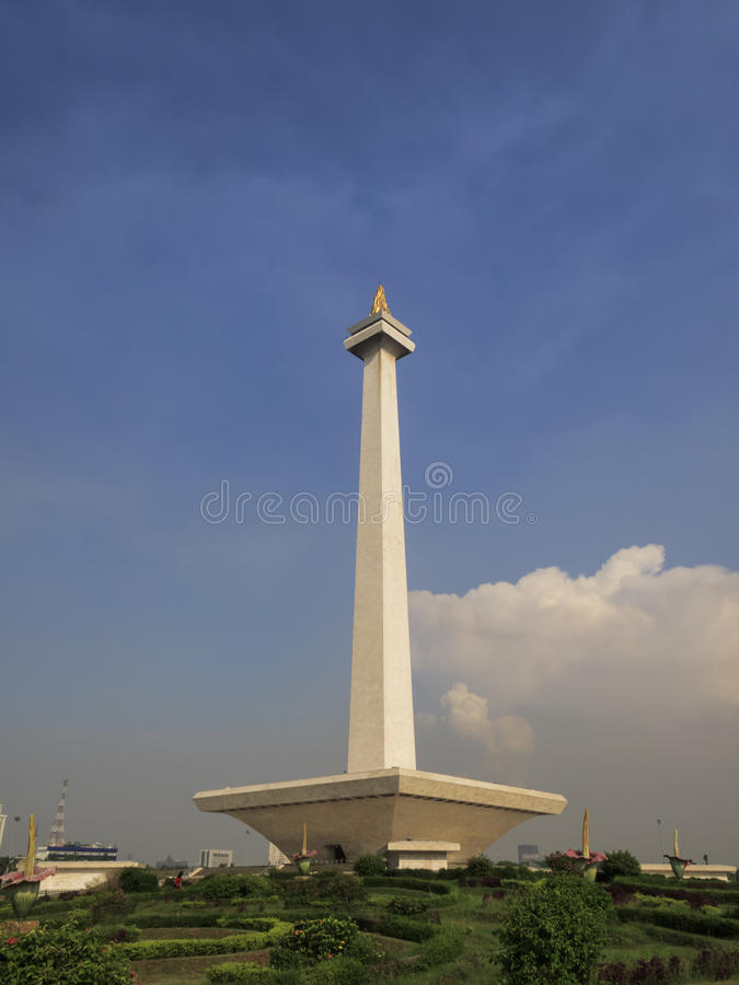 Monas, Indonesia National Monument in Jakarta. Jakarta, Indonesia: Merdeka Square View of National Monument column from garden pathway on sunny day royalty free stock photography