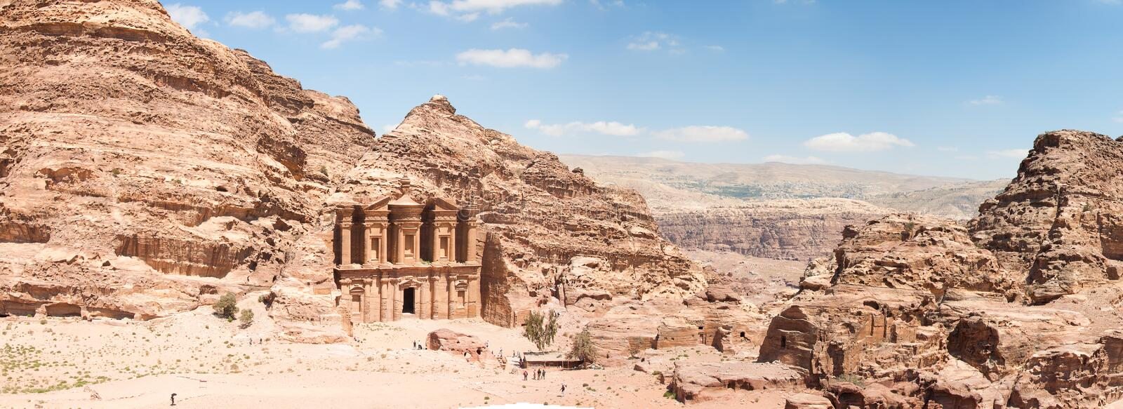 The Monastarty, Petra, Jordan. The Monastery (Ad Deir), an example of Nabatean classical style, Petra, Jordan. Panormaic view with surronding cliffs royalty free stock image