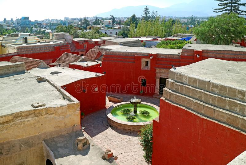 Monastery courtyard and cityscape of Arequipa view from rooftop terrace of Santa Catalina Monastery, Arequipa, Peru royalty free stock images