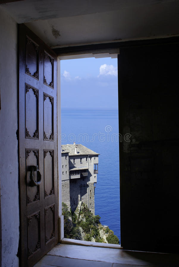 Monastery Dionisiou. On Holy mount Athos through old door stock images