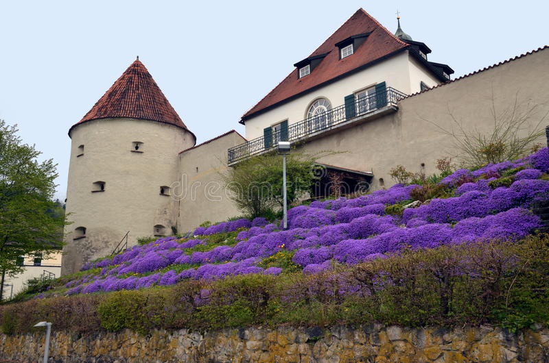 Monastery of Fussen in Bavaria, Gemany. View on monastery in Fussen surrounded by beautiful flowers. Fussen, Germany stock image