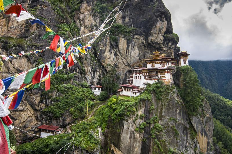Taktshang Goemba , Tiger`s nest monastery with the prayer flags , Paro , Bhutan. This monastery hanging miraculously from the cliff face . the site of Taktshang royalty free stock photos