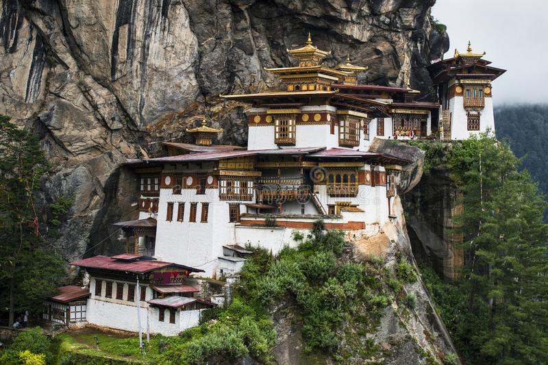 Taktshang Goemba , Tiger`s nest monastery , Paro , Bhutan. This monastery hanging miraculously from the cliff face . the site of Taktshang Goemba has long been stock photos