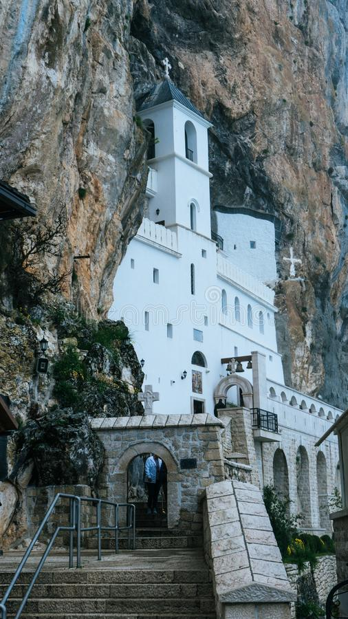 Monastery of Ostrog is a monastery of Serbian Orthodox Church placed against an almost vertical rock of Ostroska Greda, Montenegro stock photography