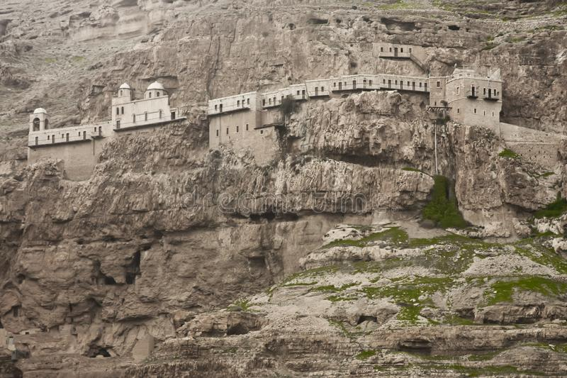 Monastery of temptation on the rock stock images