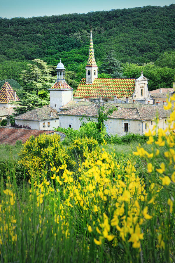 Monastery of Valbonne in Gard Provencal, France. Monastery of Valbonne founded in 1204 near Saint Paulet de Caisson in Gard Provencal, south of France ( royalty free stock images