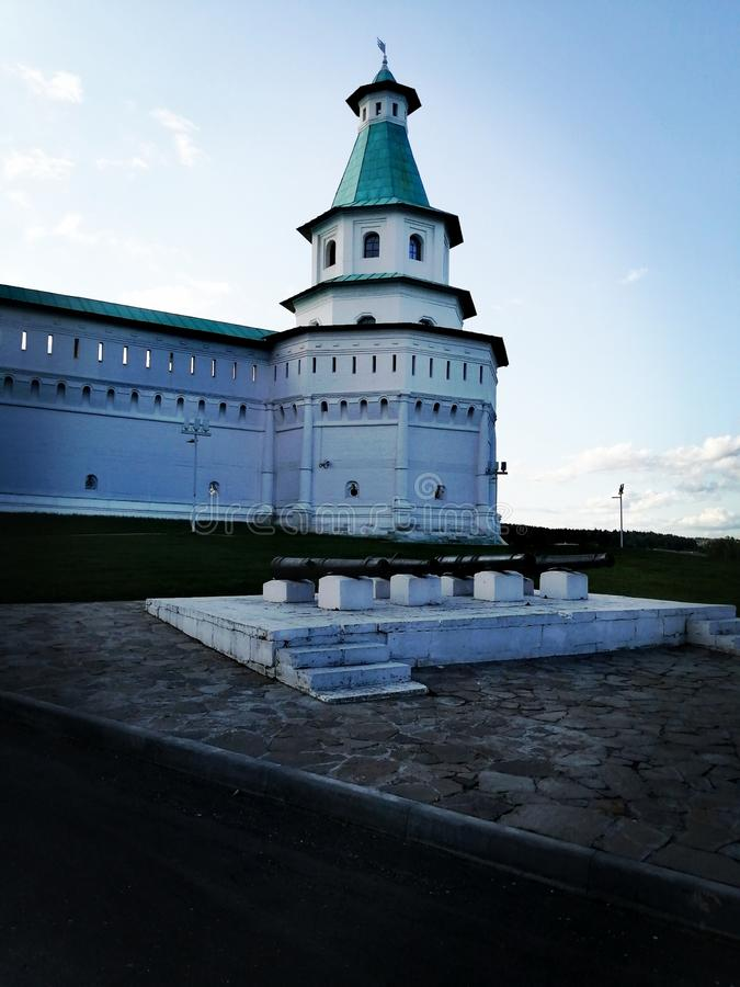 Monastery walls with longline towers and cannons royalty free stock photography
