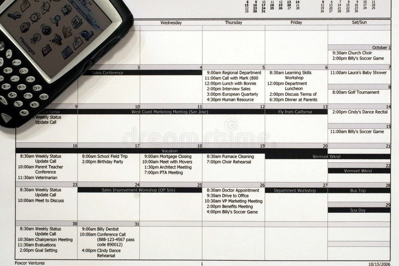 Monatsarbeits-Zeitplan u. PDA stockbild