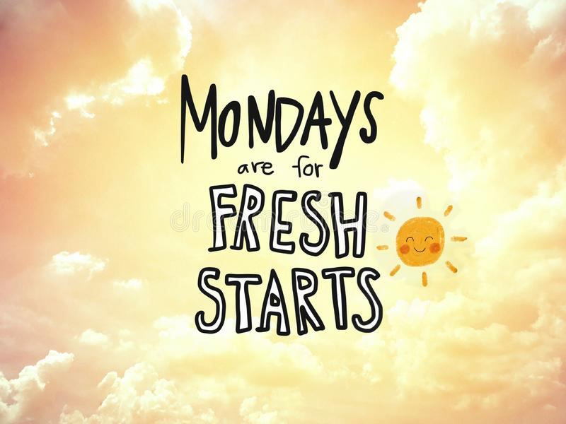 Mondays are for fresh starts word lettering and sun smile on golden sky stock photo