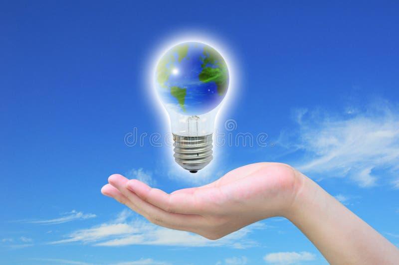 Monde dans l'ampoule photographie stock