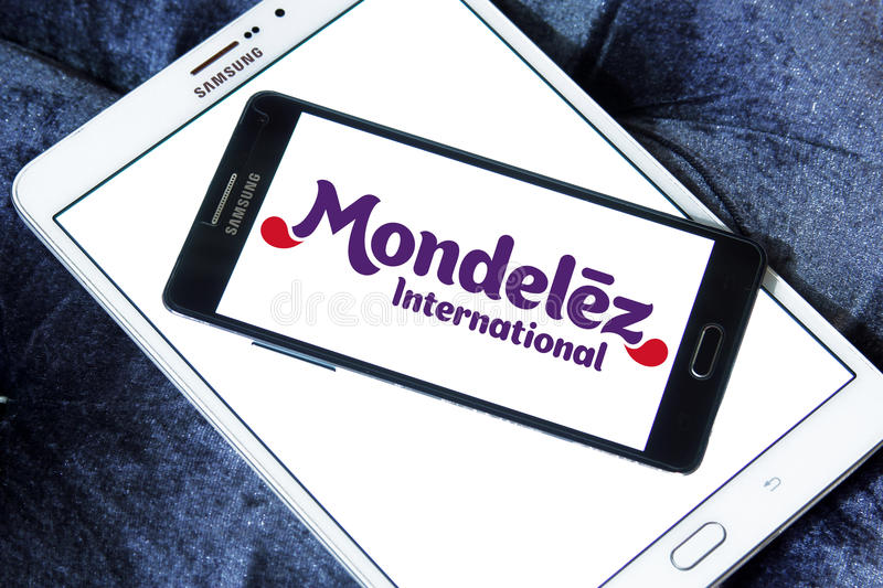 Mondelez International logo. Logo of food company Mondelez International on samsung mobile on samsung tablet. Mondelez is an American multinational confectionery stock photography