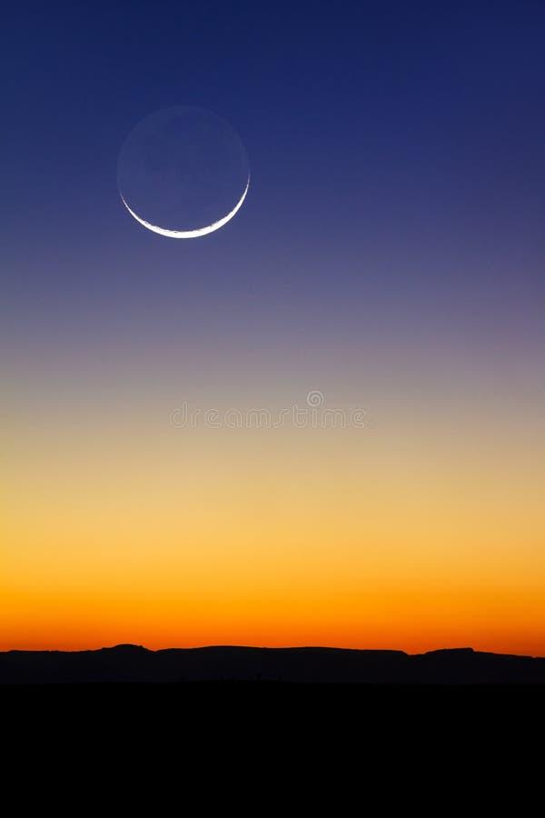 Mondsonnenuntergang stockbilder