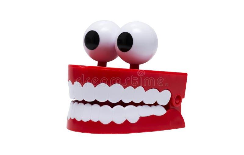 Mondstuk speelgoed, op witte achtergrond wordt geïsoleerd die Chatteringstanden op witte achtergrond stock afbeeldingen