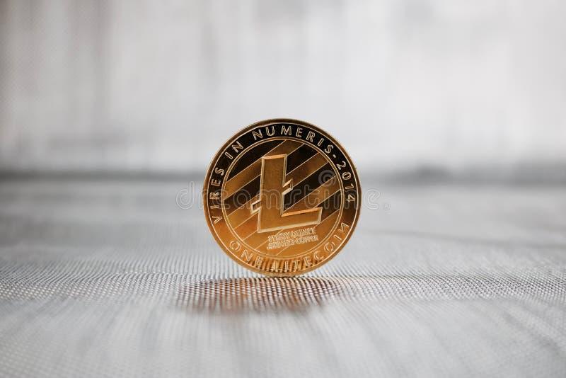 Moneda de Litecoin del oro imagenes de archivo
