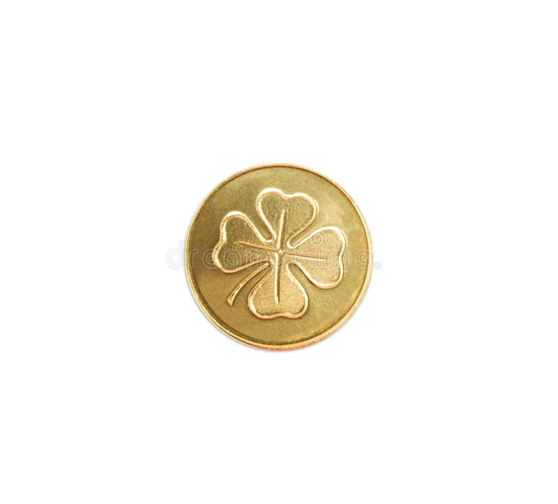 Moneda de oro con el trébol de cuatro hojas fotografía de archivo libre de regalías