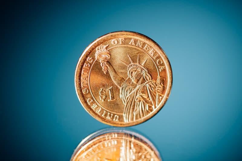 Moneda de oro del dólar imágenes de archivo libres de regalías