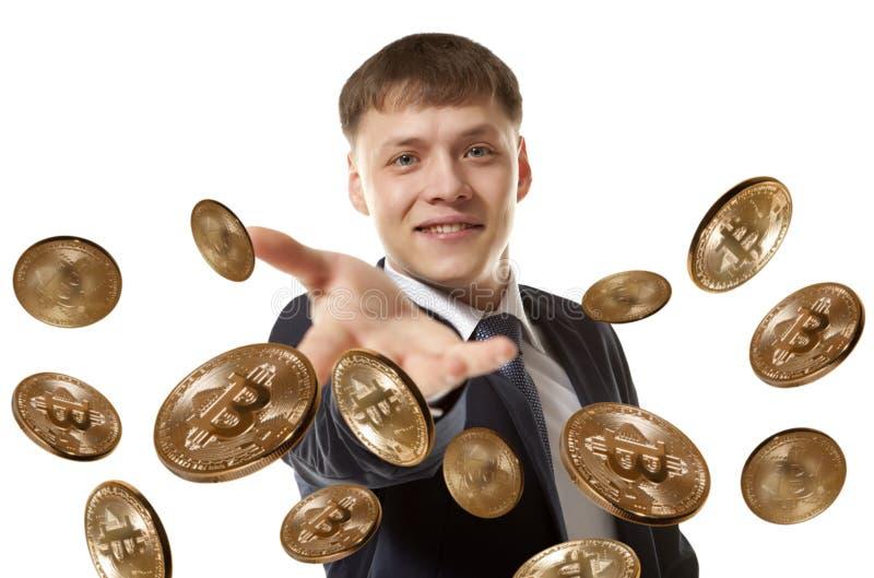 Moneda del bitcoin del hombre de negocios que lanza fotos de archivo libres de regalías