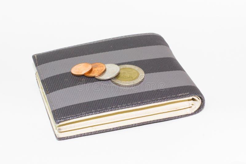 Moneda en el bolsillo o la cartera del dinero foto de archivo libre de regalías