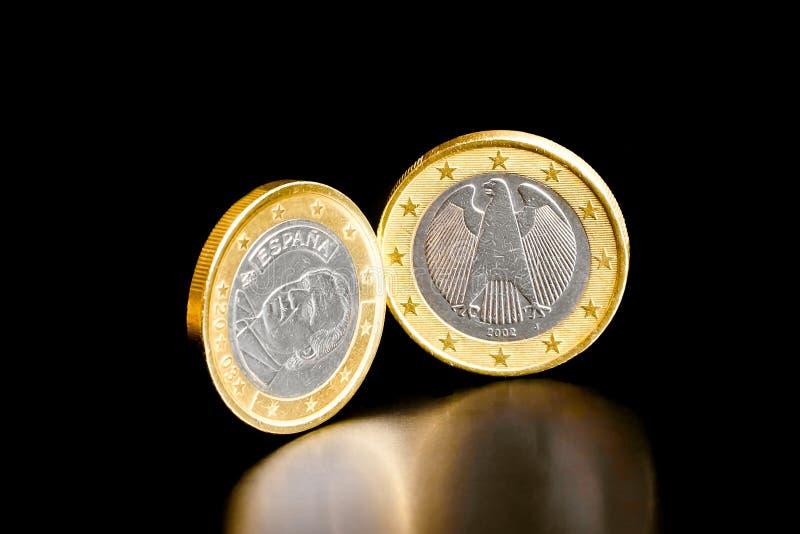 Moneda euro de Alemania y de España imagen de archivo libre de regalías