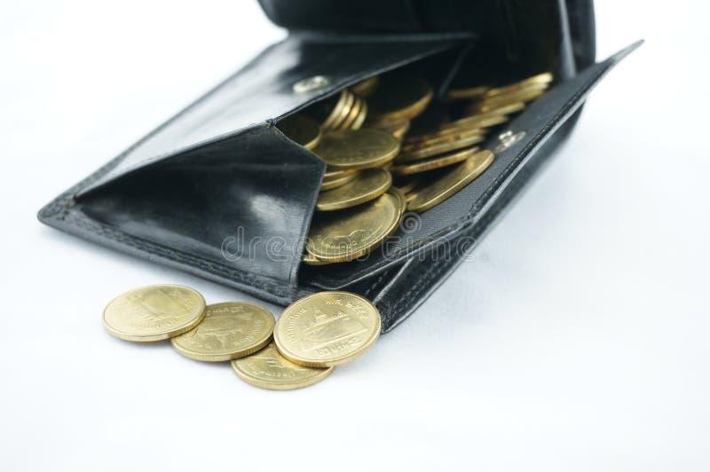 Moneda llena del bolsillo imagen de archivo
