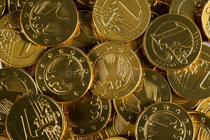 Monedas aisladas, oros fotografía de archivo