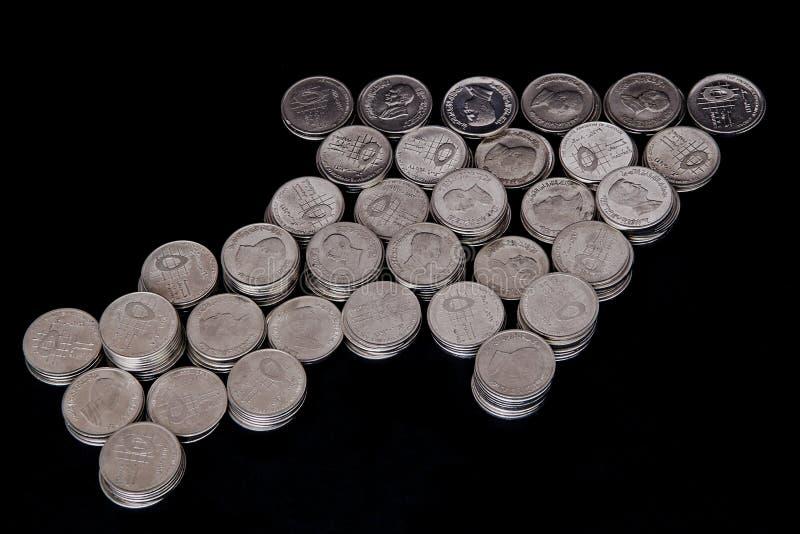 Monedas de la dimensión de una variable del puntero de ratón foto de archivo libre de regalías